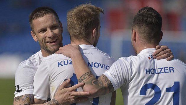 Hráči Baníku se radují z druhého gólu. Zleva Martin Fillo, autor branky Nemanja Kuzmanović a Daniel Holzer.