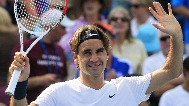 Vítězné gesto tenisty Rogera Federera.