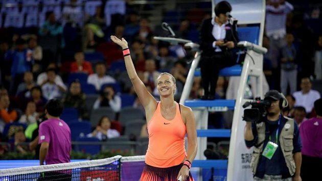 Česká tenistka Petra Kvitová se raduje z vítězství nad Rumunkou Simonou Halepovou.