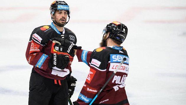 Hokejisté Sparty Praha Michal Řepík a Adam Polášek oslavují gól - ilustrační foto.