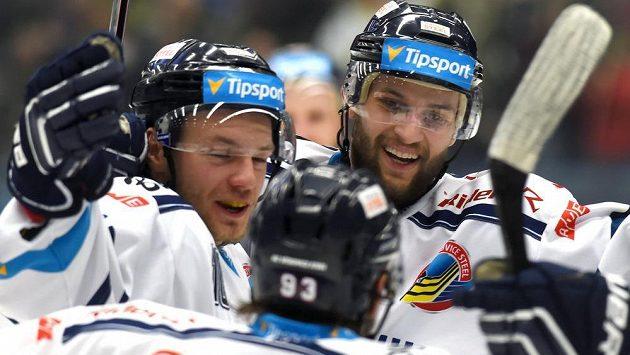 Vítkovičtí hokejisté (zleva) Štencel, Marek Hovorka a Petr Kolouch se radují z gólu - ilustrační foto.