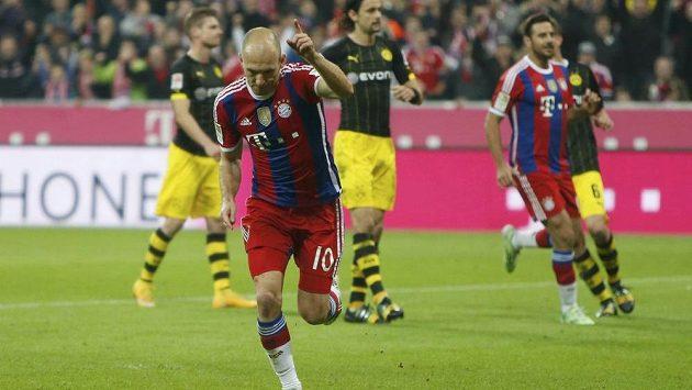 Arjen Robben se raduje z proměněné penalty, kterou rozhodl o výhře Bayernu Mnichov proti Dortmundu.