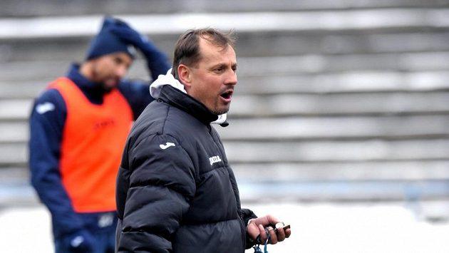 Ostravský trenér Martin Pulpit s Milanem Barošem (vzadu).