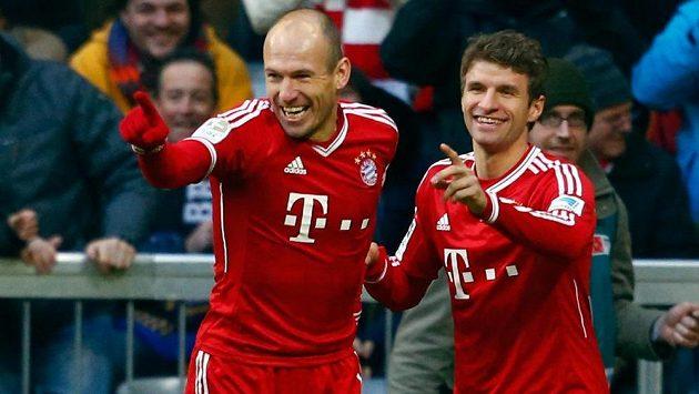Thomas Müller (vpravo) by titul věnoval kouči Juppu Heynckesovi.