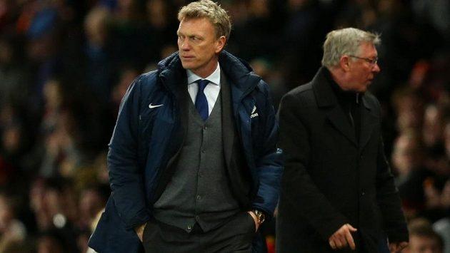 David Moyes (vlevo) nahradí legendárního Alexe Fergusona na lavičce Manchesteru United