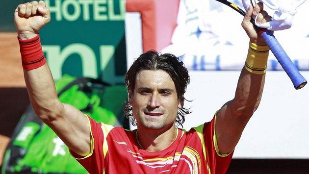 Španělský tenista David Ferrer se raduje z vítězství nad Andreasem Haiderem Maurerem z Austrálie.