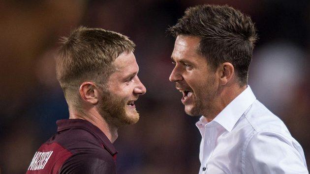 Trenér Sparty David Holoubek (vpravo) a obránce Ondřej Mazuch se radují po výhře nad Interem Milán.