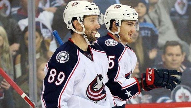 Lukáš Sedlák (vpravo) oslavuje svoji trefu proti Winnipegu.
