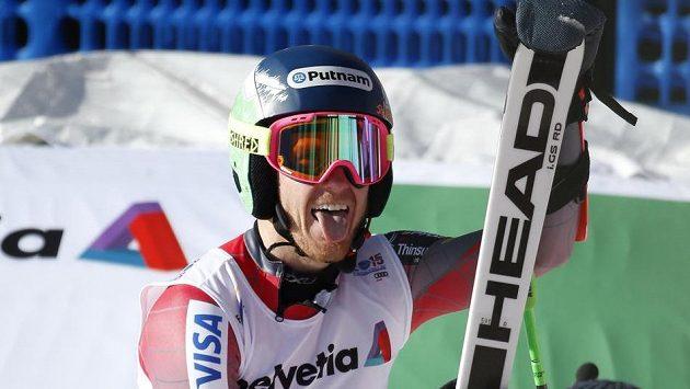 Američan Ted Ligety se raduje v cíli, jako první lyžař v historii MS vyhrál potřetí za sebou obří slalom.