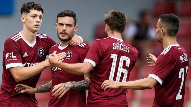Fotbalisté Sparty Ladislav Krejčí, David Moberg Karlsson, Michal Sáček a Jakub Pešek oslavují gól.