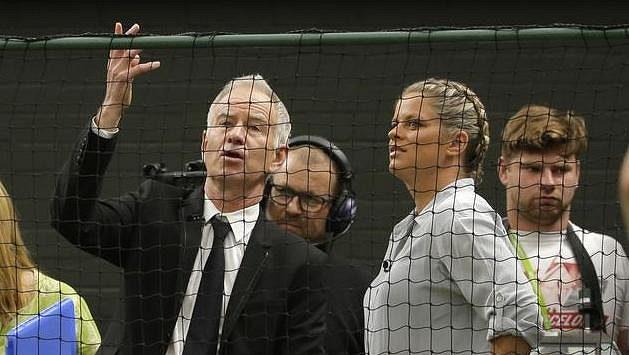 John McEnroe a Kim Clijstersová při Wimbledonu.